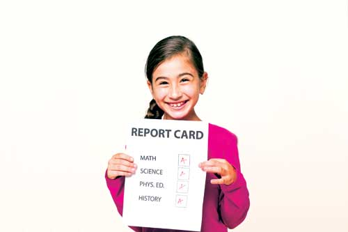 Happy Child with Excellent Report Card - Maths Tutor Toowoomba